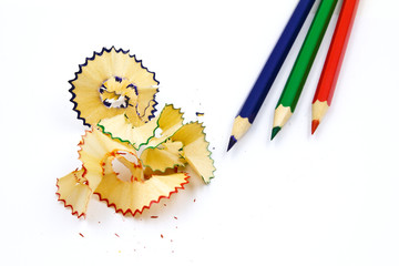 Colored pencil with colorful pencil shavings on white background