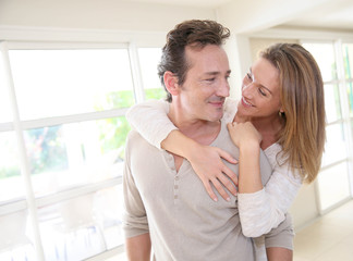 Cheerful middle-aged couple embracing each other