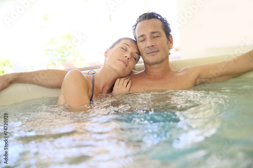 Romantic couple relaxing with eyes shut in jacuzzi - 74720928