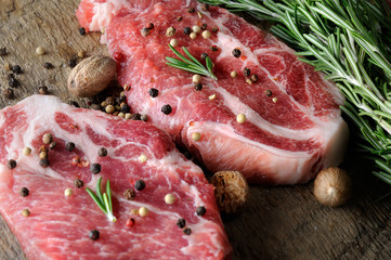 raw marble steak with herbs and spices