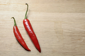 two red chilies seen from top