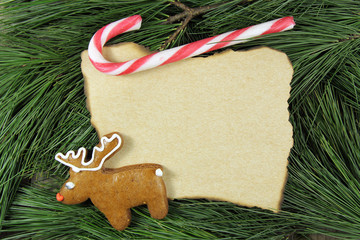 blank christmas card on fir tree with reindeer gingerbread and c