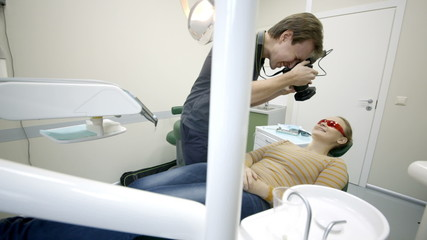 Dentist taking pictures of womans smile