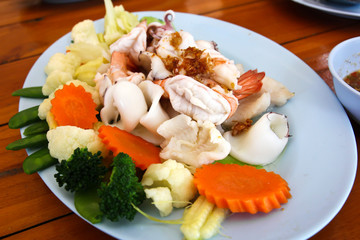 Mixed vegetables with seafood.