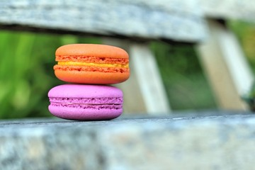 Macaroons on a wood table in a garden