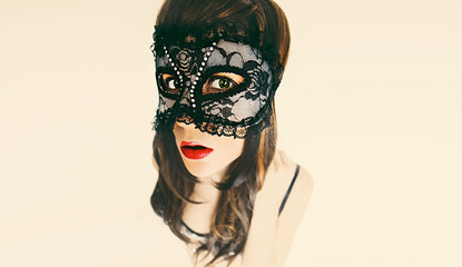 Glamorous brunette lady in masquerade mask. carnival party