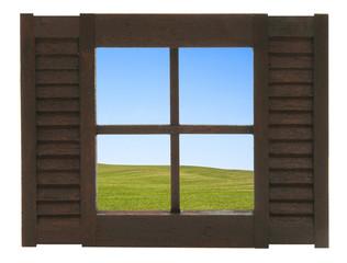 Fenster mit Aussicht auf eine Feldlandschaft