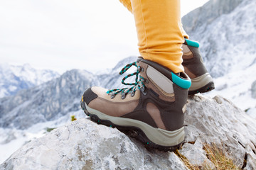 Hiking boots on mountain rocks