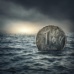 Ruble coin sinking in water
