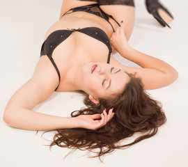 Sexual woman lying on a floor