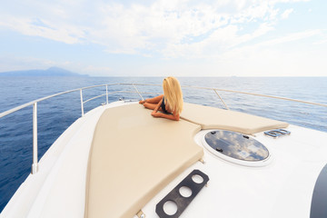 Young sexy woman enjoy on yacht at faraglioni island capri italy