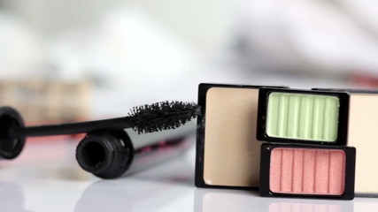 motion with make-up products on a white background