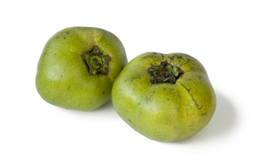 Two fresh black sapote fruit