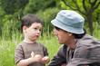 Leinwanddruck Bild - Father and child talking