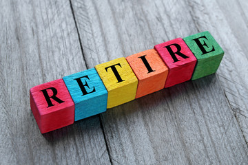 concept of retire word on colorful wooden cubes