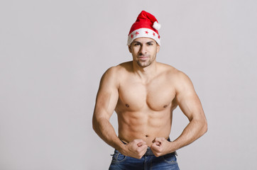 Strong Santa posing with bodybuilding pose