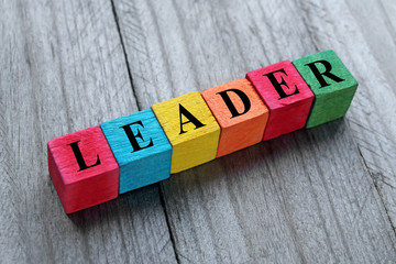 concept of leader word on colorful wooden cubes