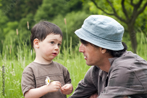Leinwanddruck Bild Father and child talking