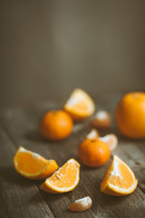 Tangerines, oranges on a wooden table