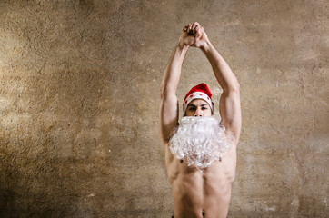 Strong Santa posing with bodybuilding pose