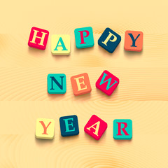Words happy new year with colorful blocks