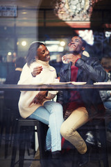 Beautiful couple in love drinking coffee and laughing in coffee