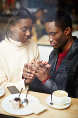 Portrait of young stylish couple in love at coffee shop