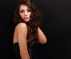 Sexy fashion female model in modern black dress posing