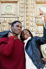 Dating couple happy in love taking self-portrait photo on beauti