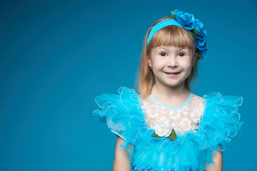 cute little girl on blue background