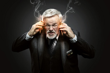 Businessman with burning Mobile Phones