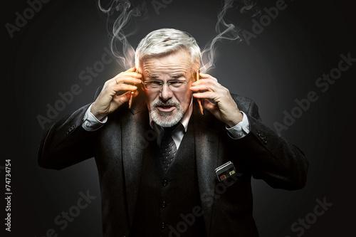 Leinwanddruck Bild Businessman with burning Mobile Phones