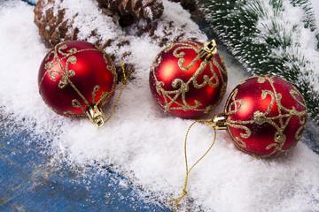 christmas balls with snow and wood