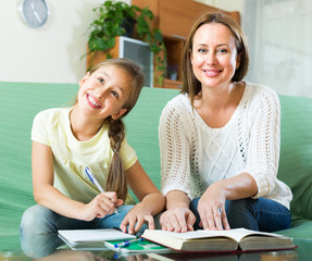 schoolgirl and mother doing homework