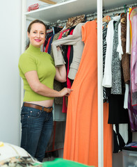 Housewife checking apparel at home