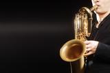 Fototapety Saxophone Saxophonist with baritone sax