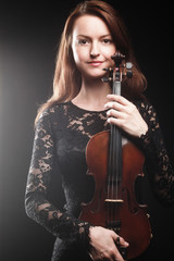 Portrait of beautiful woman with violin Player violinist
