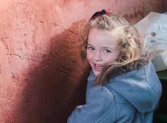 Little blonde girl smiling