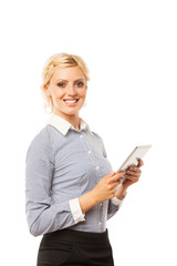 Happy young businesswoman using electronic tablet