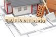 Bauplan mit Ziegelstein und Haus mit Bauantrag