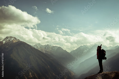 Fotobehang Alpinisme Climbing young adult at the top of summit