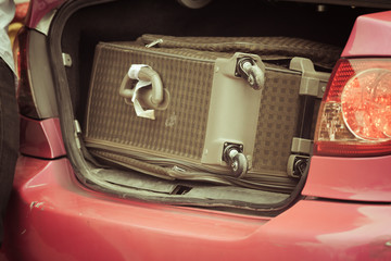 suitcase near a taxi