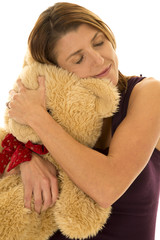 woman in purple tank hug bear closed eyes