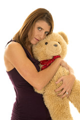 woman in purple tank hug bear serious