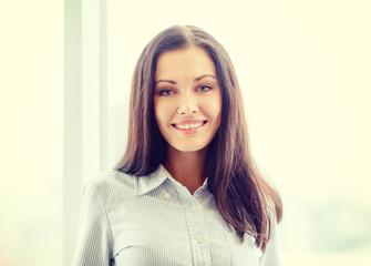 happy businesswoman in office