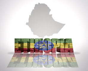 Word Ethiopia on a map background