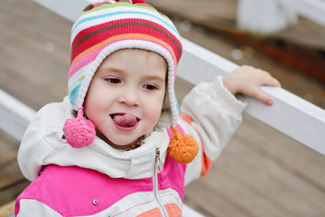 toddler girl showing tongue