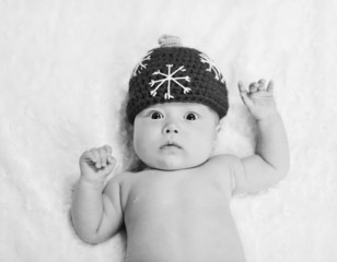 newborn baby wearing hat
