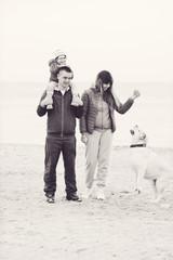 family walking near the sea