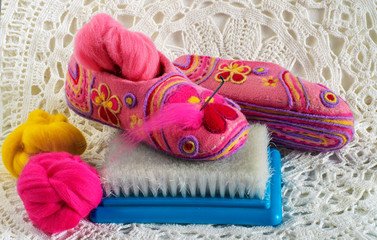 slippers, needles, brush and  wool for  felting